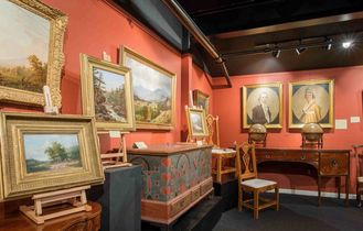 Fine art gallery at New Hampshire Antique Co-op with paintings and furniture