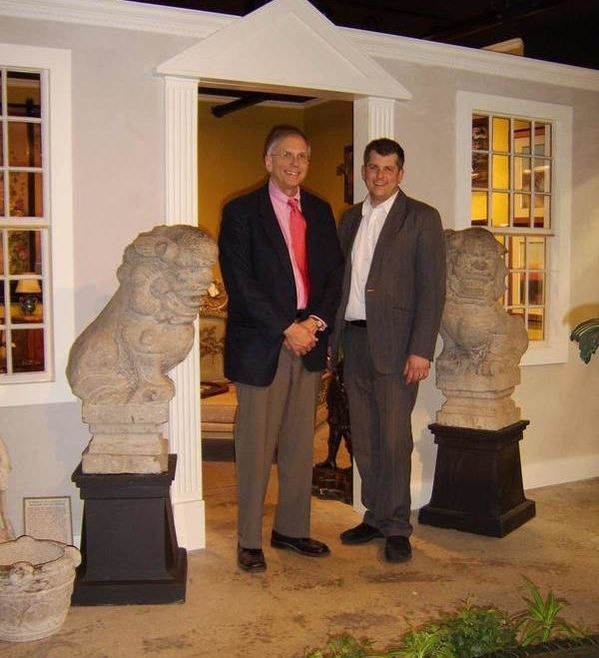Sam & Jason Hackler in the front plaza at New Hampshire Antique Co-op, flanked by two foo dog statues